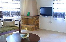 Villa (3) - Living room, open fireplace, TV